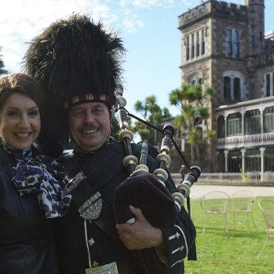 Cruising With Jane Mcdonald - Ep 1 - Jane with her backpipe teacher Dingald at Lanrach Castle, Dunedin, New Zealand