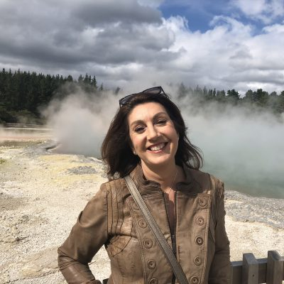 Cruising With Jane Mcdonald - Ep 2 OZ & NZ - Jane stands in front of geothermal pool at Wai-O-Tapu Thermal Wonderland.