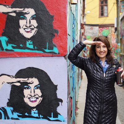 Cruising With Jane McDonald Se4 Ep 1 - Jane poses with her freshly painted graffiti in Valparaiso, Chile. Valparaiso is famous for it's street art.