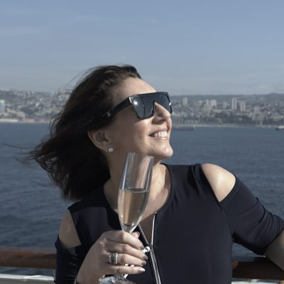 Cruising With Jane McDonald Se4 Ep 1 - Jane has a glass of Champagne to celebrate the start of the cruise.