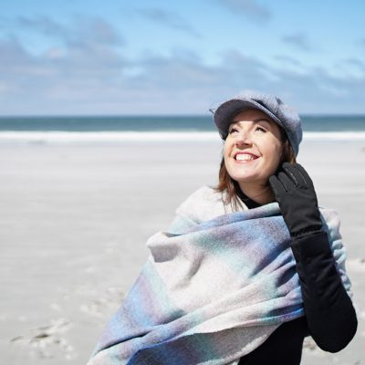 Cruising With Jane McDonald Se4 Ep 1 - Jane on the beach at Bluff Cove, Falkland Islands.